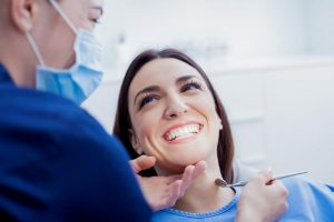 The patient is happy because of a successful dental treatment.