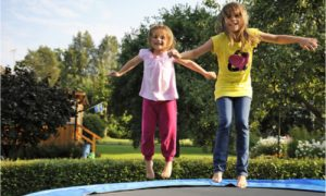 kids on trampoline with their healthy smiles