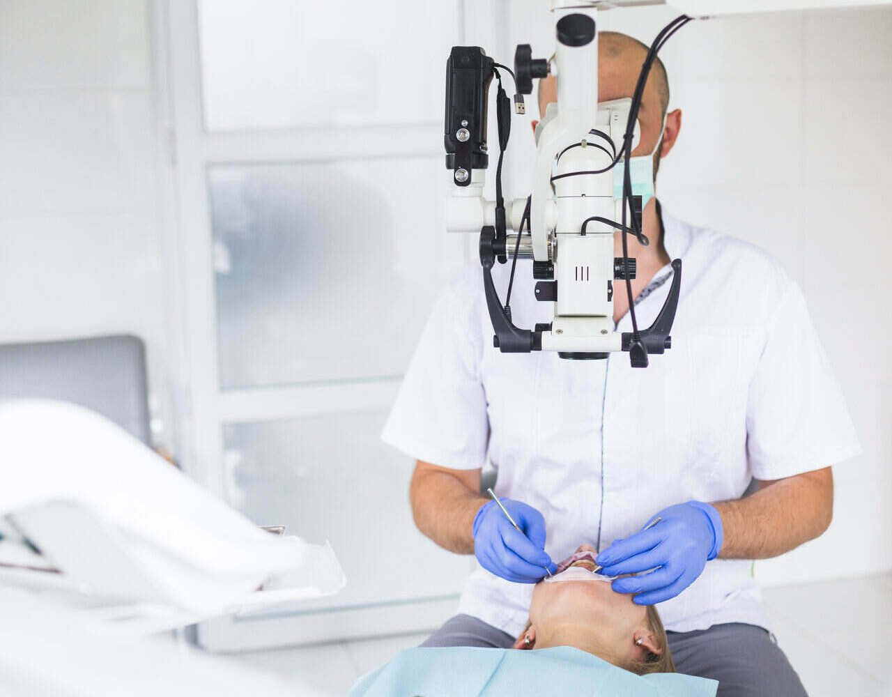 dentist checking his patient's teeth condition