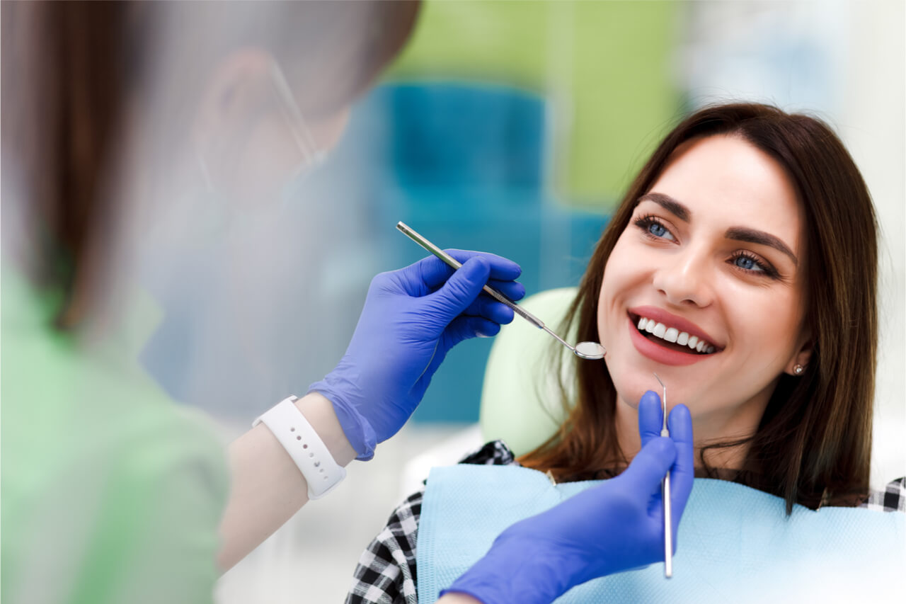 The woman visits her dentist.