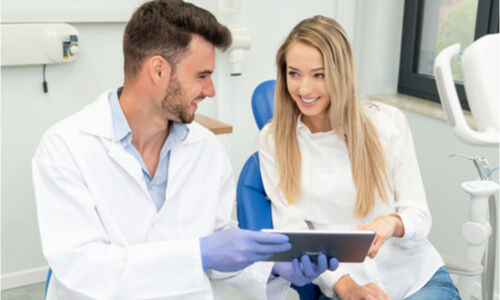 The dentist discusses the pinhole gum surgery cost.